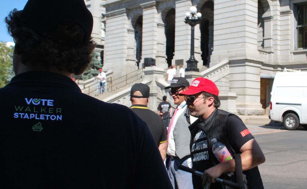 Stapleton SuperPAC staffer at rally w/ hate group