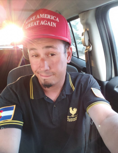 Major League Liberty host Louis Huey wearing Proud Boys shirt