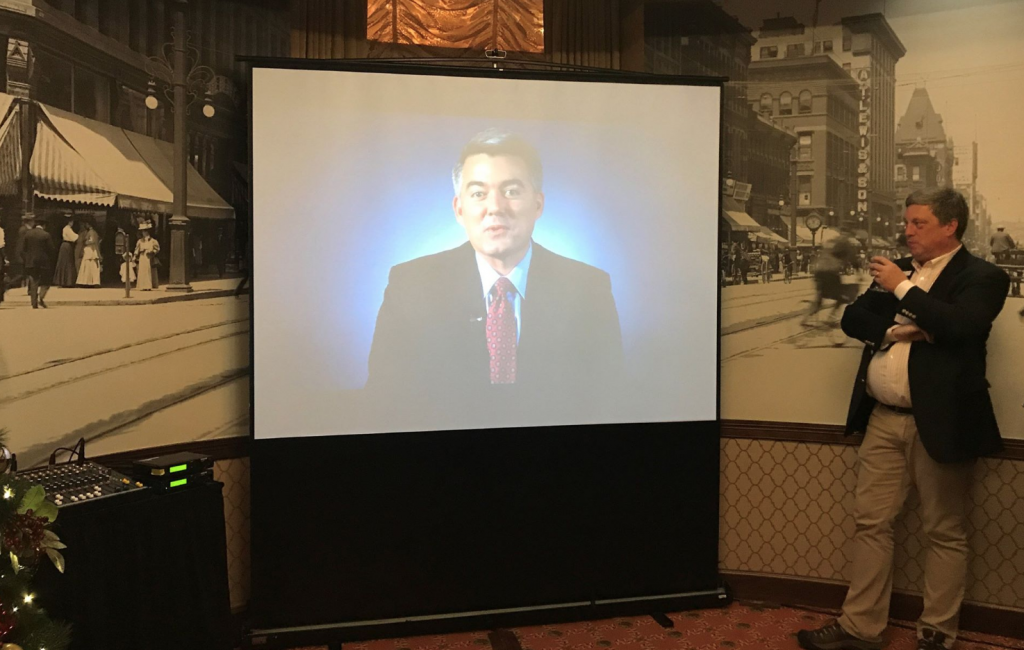 Gardner speaks remotely to his 2017 holiday party