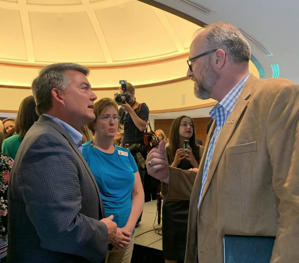 Republican candidates Sen. Cory Gardner and Corey Seulean chat at an invite-only campaign event featuring former UN Ambassador Nikki Haley